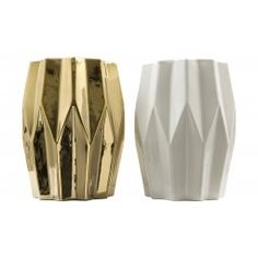 "These are not your grandmother's garden stools. Our Dover Stools are a highly stylized version of the traditional barrel shape. Available in a glamorous metallic gold glaze, or a pristine glossy white glaze, our geometrically designed Dover Stools can be used as side tables or for additional seating. Suitable for outdoor use in covered areas only.     •14"" diameter x 18.5""H		  •ceramic  •glossy white glaze or metallic gold glaze"