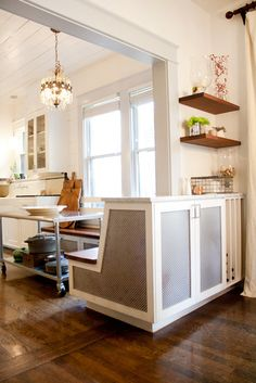 bench seating/cabinet, and an island with wheels    this space makes my heart go crazy with how clever it is