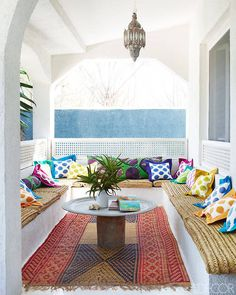 Sun room / porch with lots of seating. This one feels Moroccan with the light and rug