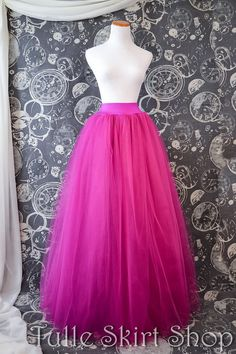 Please note: Current make time is 2-3 weeks plus shipping time. This pretty in pink skirt is constructed of layers and layers of fuchsia tulle securely sewn, not knotted, to a 2 1/2 wide lycra waistband. This lovely full length tulle skirt is perfect for any event! Dress it up or go casual, it is perfect for making a bold statement no matter the occasion. Great for Prom, bridesmaids, photo shoots, bachelorette parties or an unforgettable night out on the town! We use a beautiful soft…