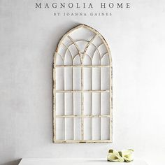 Part of the Magnolia Home Collection by Joanna Gaines, this cathedral-style window frame delivers character to any space. Crafted of iron with a distressed finish.