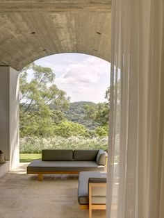 Australian Architecture, Australian Homes, Contemporary Architecture, Arched Front Door, Concrete Cover, Modern Deck, Stucco Exterior, Front Courtyard, Room With Plants