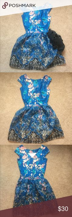 Blue Floral Two Piece Dress Beautiful floral two piece dress from New York and Company. Tulle skirt may be removed (see photos) making this a really versatile dress. Can be worn to work without skirt or put it on for a night out.  Please note that this listing is for the dress only. Other items are not included. New York & Company Dresses Midi
