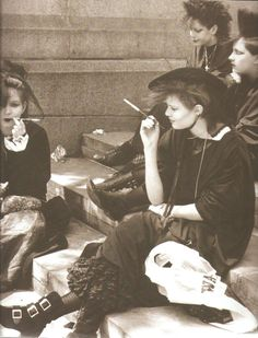 80's goth kids. They look like witches :)