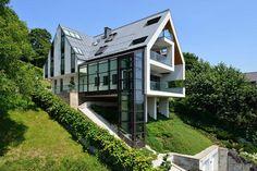 Fachadas en Terrenos con Pendiente – Fachadas de Casas