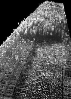Espantaleón painstakingly constructed Manhattan in clay by forming 31,920 volumetric units each representing actual buildings, at a scale of 1/65. These volumes were then used to create pixelated city blocks from which he cast silicon molds that could in turn be used to reproduce each block with epoxy resin and polyurethane.