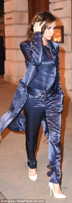 Suits you!Victoria matched a shimmering navy satin jacket with tails to tapered trousers which featured edgy buckle detail