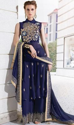 Flaunt pristine elegance dressed in this navy blue color embroidered georgette, net palazzo suit. That you can see some fascinating patterns performed with resham and stones work. #PrettyBlueTransparentLawWaistPalazzoSuit