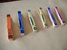 Crayon wrappers modge podged onto clothespins. Cute way to hang artwork by PoppetC