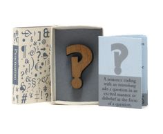 Cover, book and attached interrobang in matchbox book