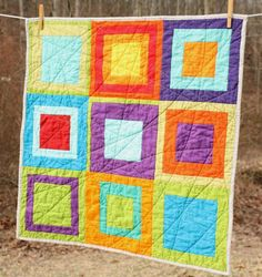 Solids Baby Quilt by Erin @ Why Not Sew? Quilts, via Flickr -- love the random curved line quilting