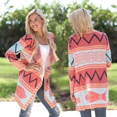 OMG, LOVE IT! How could we not fall head over heels for this Coral and Mint Long Cardigan?! This look is so chic, comfortable and easy to wear. The adorable color combination and amazing print are why we've officially made this a MUST HAVE! Such a sophisticated piece for everyday wear - whether it's to work or school! See other cardigans at our online boutique!