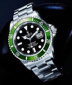 Prototype Rolex 50th Anniversary LV Submariner This is a Rolex press kit photograph of a prototype LV Submariner that was never sold. You can tell it is a prototype because it has spring-bar holes on the outside of the lugs as you can see. The production model lacks the holes.