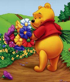 Winnie de Pooh met veel tattoos bloemen plukken