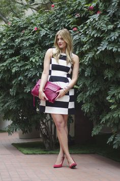 black and white mod dress with pops of pink and red