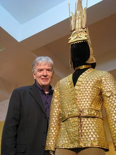 The Saka Warrior with curator. A symbol of independent Kazakhstan, the Golden Man was a Saka Warrior found intact in a burial mound in Issyk. His costume is leather and gold.