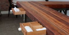 In collaboration with Dumptruck design, @gindesigns, detail photo of utensil and napkin drawers in Oxheart's kitchen wrap around seating reclaimed wood table.