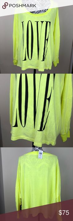 "Wildfox oversized sweater love NWT In a fun neon yellow color ""love"" sweater from Wildfox. Size large Wildfox Sweaters"