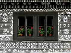 slovakia207: Slovakia - Cicmany village: folk architecture reserve - window with flower pots - Zilina district - photo by J.Kaman - (c) Travel-Images.com - Stock Photography agency - Image Bank