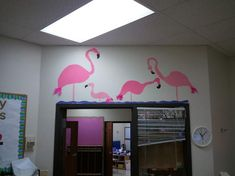 Flamingos I made with pink and black construction paper. I took pink feathers and put it on their back side!