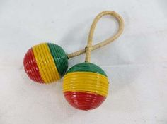 rasta tribal percussion music instrument double twisted ball shaker $6 - http://www.wholesalesarong.com/blog/rasta-tribal-percussion-music-instrument-double-twisted-ball-shaker-6/