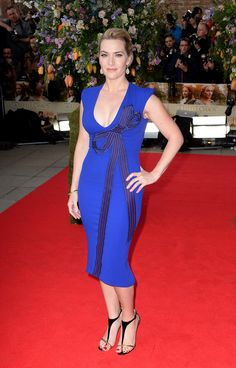 Kate Winslet wearing Stella McCartney bluebird dress with bow embroidery detail from the Autumn 2015 collection in London. Photo courtesy of Getty Images.
