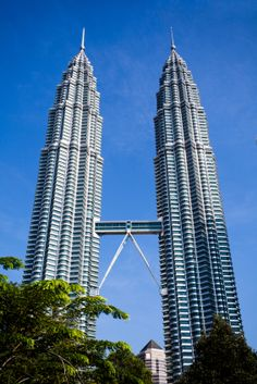 The Petronas Towers are twin skyscrapers in the central business district of Kuala Lumpur, Malaysia. It has a distinctive post modern style, and currently stands as one of the tallest buildings in the world.