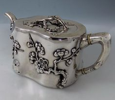 Tea Pot with applied flowers