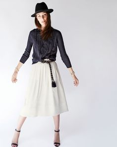 J.Crew women's cable crewneck sweater with fringe, pleated midi skirt, classic felt hat with leather band, tassel rope belt, mix brûlée bracelet, petal cup cuff bracelet and high-heel ankle-strap sandals.