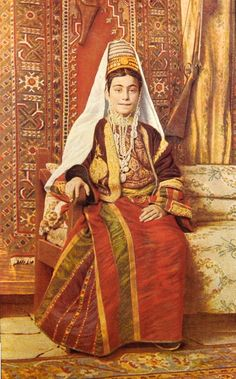 Women of Bethlehem 128 (late 19th, early 20th c.) - A Palestinian womanof Bethlehem in her bridal gown (Thob Al Malak, head dress (Shatweh), short velvet jacket (Taksireh)