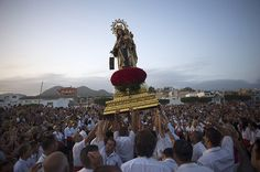 24 hours: Malaga, Spain: Penitents take part in the Virgen del Carmen procession