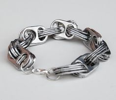 Awesome bracelet made of pop can tabs! Totally want one.., who can make this for me? Lol Soda Tabs, Pop Tab Bracelet, Bracelets, Diy Jewelry, Crafts To Make, Fun Crafts, Recycle Cans, Repurpose, Pop Cans
