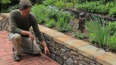Idea for replacing the retaining wall in the back yard.  Building a Small Landscape Retaining Wall | eHow