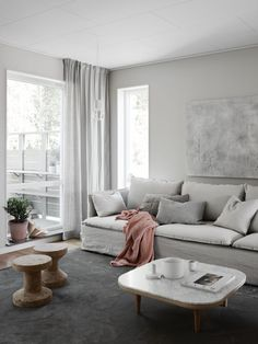 cosy yet minimal living room with a light, tonal colour scheme | this model home was styled by Pella Hedeby for JM | &tradition wood and marble coffee table | IKEA Söderhamn sofa with a Bemz Loose Fit Urban cover in Unbleached Rosendal Pure Washed Linen