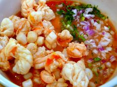 Ceviche..I lived on this growing up in Acapulco - this is the closet I've seen to the real thing - we didn't use scallops, but otherwise, this is the real deal, Mexican style.  South American countries all have their own wonderful types of ceviche, but this will always be my fave. Takes FRESH to a new level!