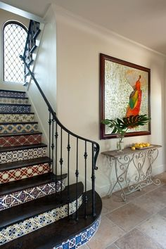 Mediterranean Staircase with High ceiling, Hardwood floors, Arched window, Mexican tile pattern mix