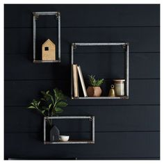 The three shelves in this set feature welded metal frames with a wooden shelf in a natural finish.