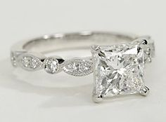 Vintage-inpired, this diamond engagement ring is crafted in platinum and features petite diamonds set in a marquise and dot pattern with milgrain edges to frame your center diamond. Setting includes 1/5 carat total diamond weight.