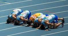 The Uzbekistan team prays on the track after winning the Bronze Medal in the Men's 4x100m - T11-13 Final, during the Paralympic Games in Rio de Janeiro, Brazil, on September 13, 2016.  Photo by Al Tielemans for OIS/IOC via AFP.  RESTRICTED TO EDITORIAL USE.    / AFP / OIS/IOC / Al Tielemans for OIS/IOC