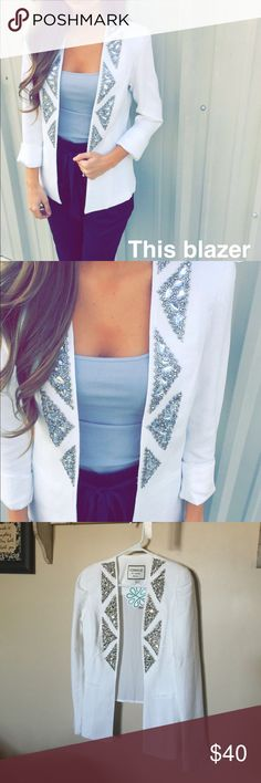 White Jeweled Blazer This is a brand new with tags white polyester blazer with a chiffon inlay on the back. It has silver jewels on the front and shoulder pads. Beautiful eye catching blazer! Size medium. NWT Jackets & Coats Blazers