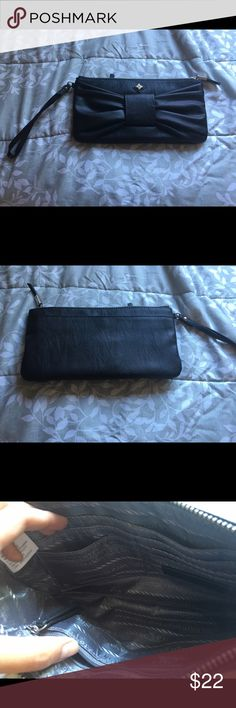 Black leather bow wristlet Black leather bow wristlet by Simply Vera Wang. Super cute, great for any formal event. Only used once, practically new. No signs of wear Simply Vera Vera Wang Bags Clutches & Wristlets