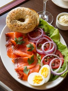 Smoked #Salmon & Everything with a toasted everything bagel, tomatoes, bibb lettuce, hard-boiled egg, sliced red onion, capers, cream cheese, and louie dressing