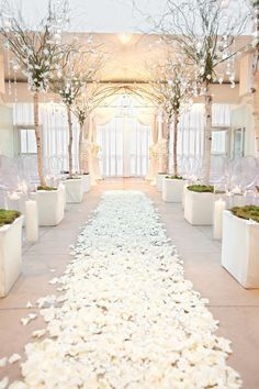 """An aisle of white rose petals and branches dripping with crystals create a """"winter wonderland"""" atmosphere at this rooftop wedding! // wedding planner: DFW Events 