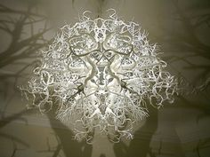 A chandelier that turns a room into a forest - Design daily news
