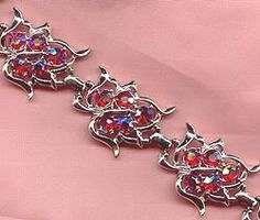 Sarah Coventry Dazzling Auroroa Bracelet Find it for sale with brooch & earrings here: http://vintagecostumejewels.com/Jewels/Sarah_Coventry_Jewelry.htm#Sarah Coventry Dazzling Aurora AB Rhinestone Bracelet.