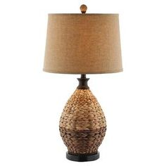 "Rattan table lamp with a tapered drum shade.  Product: LampConstruction Material: Resin, metal, and fabricColor: BrownAccommodates: (1) 150 Watt bulb - not includedDimensions: 28"" H x 15"" Diameter"
