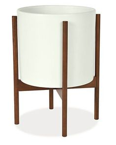 Add a touch of Mid-Century modernism with our Case Study Planters. The mix of matte glazed ceramic and weatherproof Brazilian walnut creates a sculptural foundation for your flowers or greenery. You can oil the wood to keep its rich color, or allow it to develop a silver patina. These elegant planters can be used indoors or out, but we recommend bringing them inside if temperatures drop below freezing.
