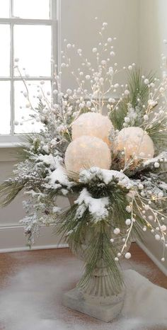 Lighted Snowballs, frosted cedar branch, and pom pom branches make a lovely Winter Wonderland  bouquet for a bridal shower.                                                                                                                                                                                 More