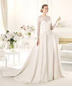 Para quem casa no inverno, esse vestido com as mangas de renda, Elie Saab é perfeito!