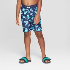 5cfd95c2d7aeb Whether he's headed to the pool or beach, your little adventurer will be  cozy and stylish with these Sharks Swim Trunks. Made from a soft fabric  material,.